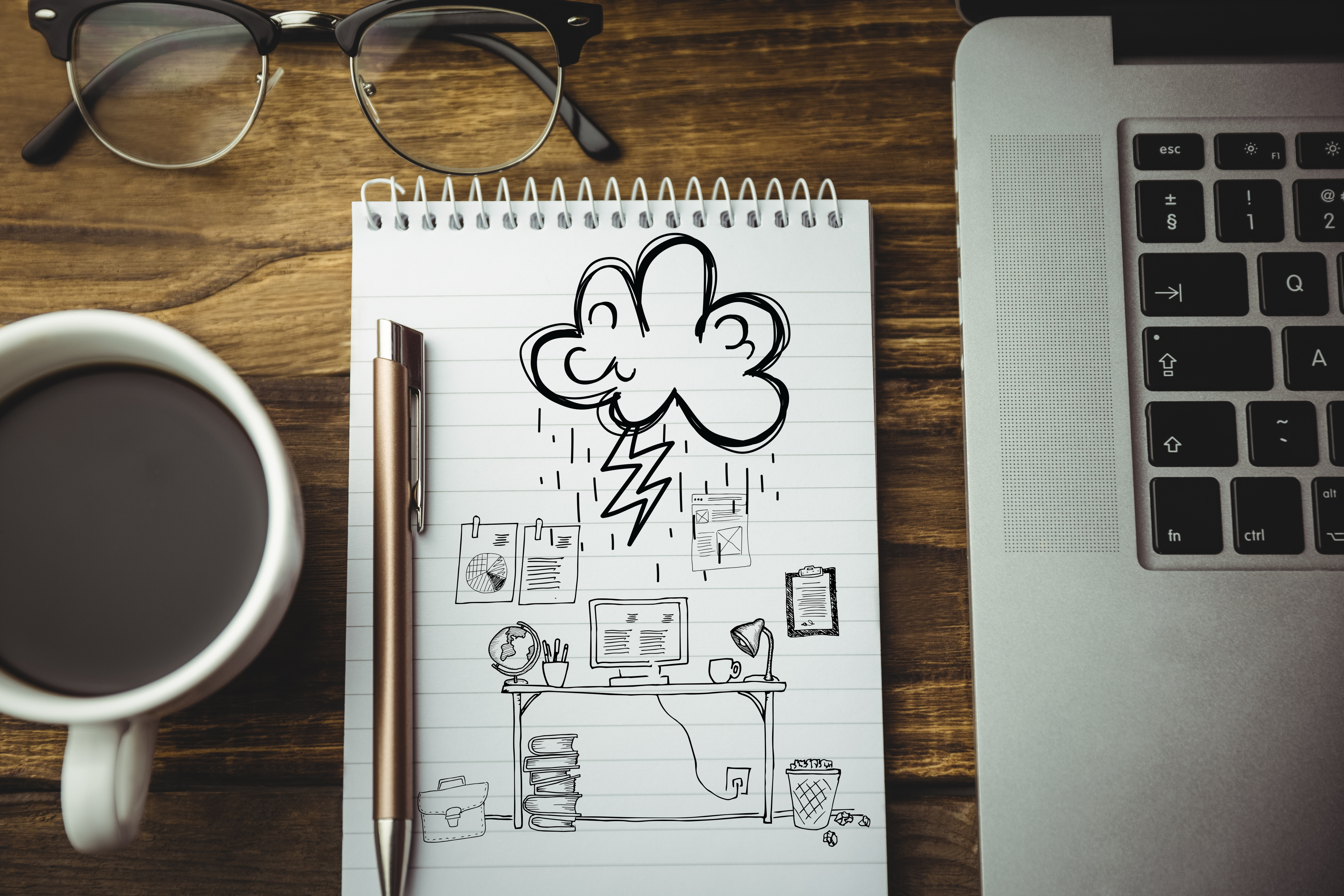 digital composite of notebook with laptop coffee and graphics